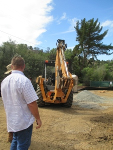Photo of tractor at Fallbrook lot getting ready to dig trenches