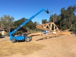 DCarson Construction is using a crane to set the tress on the Fallbrook Ranch House